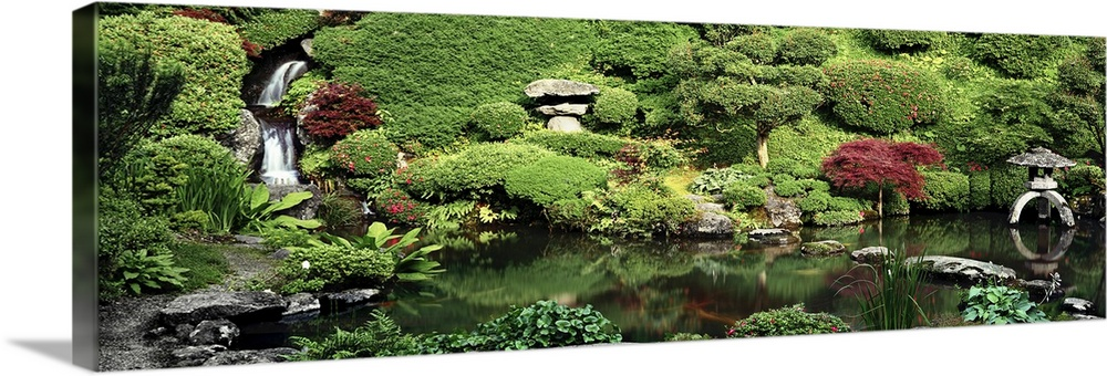 Large Solid-Faced Canvas Print Wall Art Print 36 x 12 entitled Pond in a formal garden, Japanese Tea Garden, Kozan-Ji, Yam... Solid-Faced Canvas Print entitled Pond in a formal garden, Japanese Tea Garden, Kozan-Ji, Yamagata, Japan.  Multiple sizes available.  Primary colors within this image include Brown, Forest Green, Light Yellow, Black.  Made in USA.  Satisfaction guaranteed.  Inks used are latex-based and designed to last.  Canvas depth is 1.25 and includes a finished backing with pre-installed hanging hardware.  Canvas is handcrafted and made-to-order in the United States using high quality artist-grade canvas.