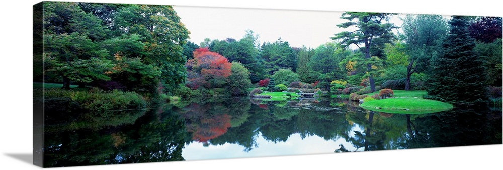 Large Solid-Faced Canvas Print Wall Art Print 48 x 16 entitled Pond in a garden, Asticou Azalea Garden, Northwest Harbor, ... Solid-Faced Canvas Print entitled Pond in a garden, Asticou Azalea Garden, Northwest Harbor, Maine, New England.  Panoramic photograph of the vibrant Asticou Azalea Garden reflecting in the water of a large pond, in Northwest Harbor, Maine.  Multiple sizes available.  Primary colors within this image include Forest Green, Black, Gray, White.  Made in USA.  Satisfaction guaranteed.  Inks used are latex-based and designed to last.  Canvas depth is 1.25 and includes a finished backing with pre-installed hanging hardware.  Archival inks prevent fading and preserve as much fine detail as possible with no over-saturation or color shifting.