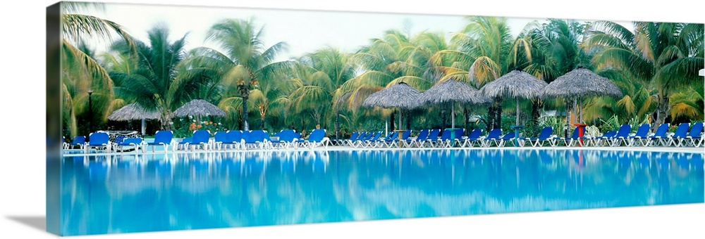 Large Solid-Faced Canvas Print Wall Art Print 48 x 16 entitled Pool and Pool Chairs Solid-Faced Canvas Print entitled Pool and Pool Chairs.  Multiple sizes available.  Primary colors within this image include White, Dark Forest Green, Royal Blue, Teal.  Made in the USA.  All products come with a 365 day workmanship guarantee.  Inks used are latex-based and designed to last.  Canvas is handcrafted and made-to-order in the United States using high quality artist-grade canvas.  Archival inks prevent fading and preserve as much fine detail as possible with no over-saturation or color shifting.
