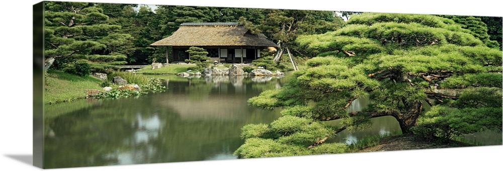 Large Solid-Faced Canvas Print Wall Art Print 36 x 12 entitled Reflection of trees in water, Tea House, Imperial Gardens, ... Solid-Faced Canvas Print entitled Reflection of trees in water, Tea House, Imperial Gardens, Kyoto Prefecture, Honshu, Japan.  Multiple sizes available.  Primary colors within this image include Gray, White, Dark Forest Green.  Made in the USA.  Satisfaction guaranteed.  Archival-quality UV-resistant inks.  Canvas depth is 1.25 and includes a finished backing with pre-installed hanging hardware.  Canvas is handcrafted and made-to-order in the United States using high quality artist-grade canvas.