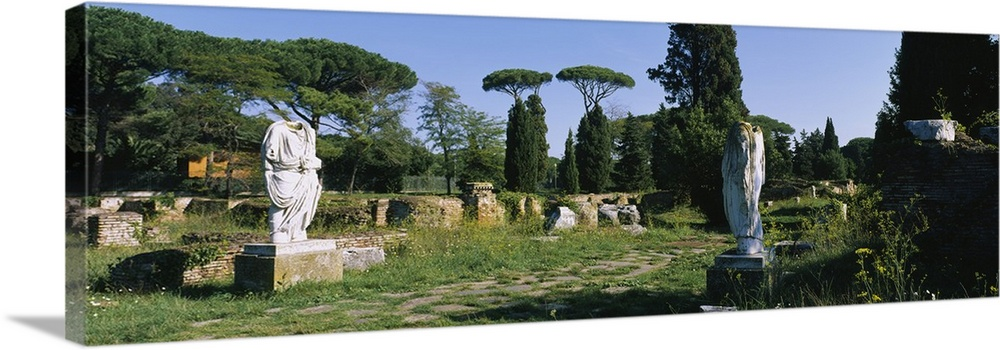 Large Solid-Faced Canvas Print Wall Art Print 48 x 16 entitled Ruins of statues in a garden, Ostia Antica, Rome, Italy Solid-Faced Canvas Print entitled Ruins of statues in a garden, Ostia Antica, Rome, Italy.  Multiple sizes available.  Primary colors within this image include Forest Green, Sky Blue, Black, Silver.  Made in the USA.  Satisfaction guaranteed.  Archival-quality UV-resistant inks.  Canvas is handcrafted and made-to-order in the United States using high quality artist-grade canvas.  Canvas depth is 1.25 and includes a finished backing with pre-installed hanging hardware.