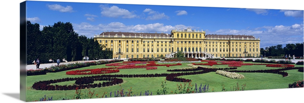 Large Solid-Faced Canvas Print Wall Art Print 48 x 16 entitled Schonbrunn Palace and Gardens Vienna Austria Solid-Faced Canvas Print entitled Schonbrunn Palace and Gardens Vienna Austria.  Multiple sizes available.  Primary colors within this image include Forest Green, Peach, Royal Blue, Dark Navy Blue.  Made in the USA.  All products come with a 365 day workmanship guarantee.  Inks used are latex-based and designed to last.  Featuring a proprietary design, our canvases produce the tightest corners without any bubbles, ripples, or bumps and will not warp or sag over time.  Canvas is handcrafted and made-to-order in the United States using high quality artist-grade canvas.
