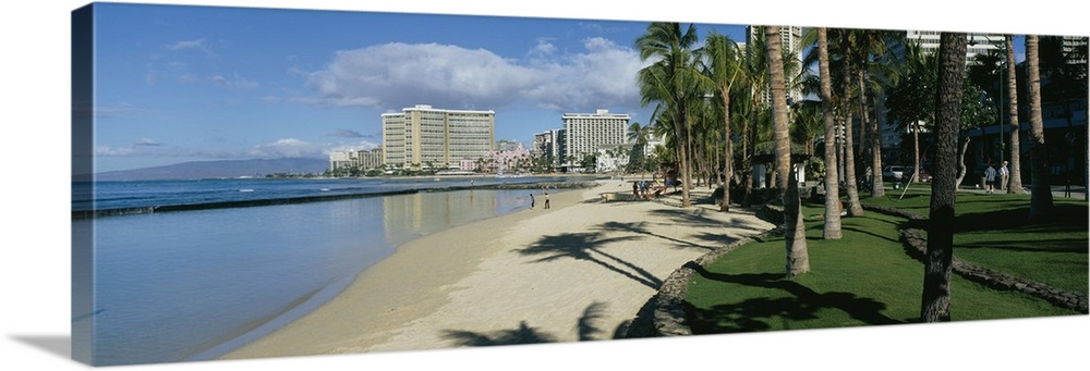 Large Solid-Faced Canvas Print Wall Art Print 48 x 16 entitled Shadow of palm trees on the beach, Waikiki Beach, Waikiki, ... Solid-Faced Canvas Print entitled Shadow of palm trees on the beach, Waikiki Beach, Waikiki, Oahu, Hawaii.  Multiple sizes available.  Primary colors within this image include Black, Silver, Dark Forest Green, Royal Blue.  Made in USA.  All products come with a 365 day workmanship guarantee.  Archival-quality UV-resistant inks.  Featuring a proprietary design, our canvases produce the tightest corners without any bubbles, ripples, or bumps and will not warp or sag over time.  Archival inks prevent fading and preserve as much fine detail as possible with no over-saturation or color shifting.
