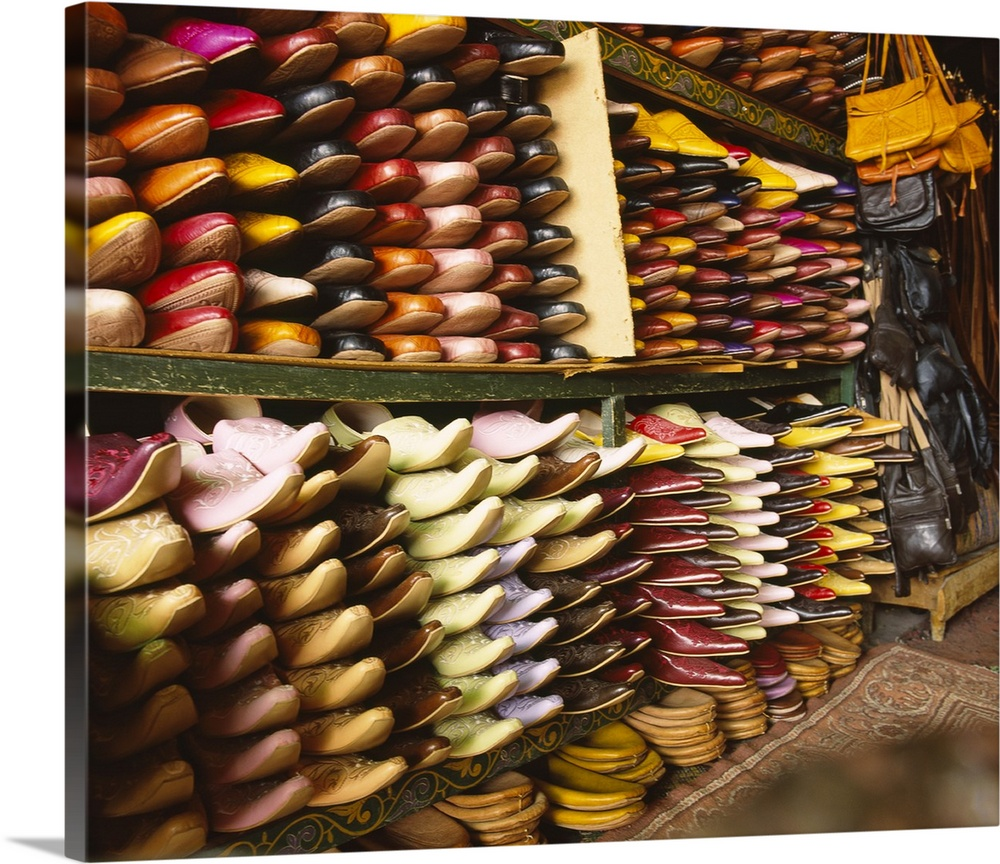 Large Gallery-Wrapped Canvas Wall Art Print 20 x 16 entitled Shoes in a store, Fez, Morocco Gallery-Wrapped Canvas entitled Shoes in a store, Fez, Morocco.  Multiple sizes available.  Primary colors within this image include Orange, Dark Red, Light Yellow, Black.  Made in the USA.  Satisfaction guaranteed.  Inks used are latex-based and designed to last.  Canvases are stretched across a 1.5 inch thick wooden frame with easy-to-mount hanging hardware.  Canvas is a 65 polyester, 35 cotton base, with two acrylic latex primer basecoats and a semi-gloss inkjet receptive topcoat.