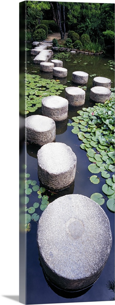 Large Solid-Faced Canvas Print Wall Art Print 16 x 48 entitled Shrine Garden Kyoto Japan Solid-Faced Canvas Print entitled Shrine Garden Kyoto Japan.  A tall panoramic piece of large stepping stones that create a path through the water in a shrine garden.  Multiple sizes available.  Primary colors within this image include Gray, White, Dark Forest Green, Dark Navy Blue.  Made in USA.  Satisfaction guaranteed.  Inks used are latex-based and designed to last.  Canvas is handcrafted and made-to-order in the United States using high quality artist-grade canvas.  Archival inks prevent fading and preserve as much fine detail as possible with no over-saturation or color shifting.