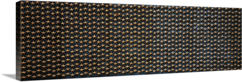 Large Solid-Faced Canvas Print Wall Art Print 60 x 20 entitled Star mounted on the wall of a war memorial Freedom Wall Nat... Solid-Faced Canvas Print entitled Star mounted on the wall of a war memorial Freedom Wall National World War II Memorial Washington DC.  Multiple sizes available.  Primary colors within this image include Brown, Peach, Black, Gray Blue.  Made in the USA.  Satisfaction guaranteed.  Archival-quality UV-resistant inks.  Featuring a proprietary design, our canvases produce the tightest corners without any bubbles, ripples, or bumps and will not warp or sag over time.  Canvas is handcrafted and made-to-order in the United States using high quality artist-grade canvas.