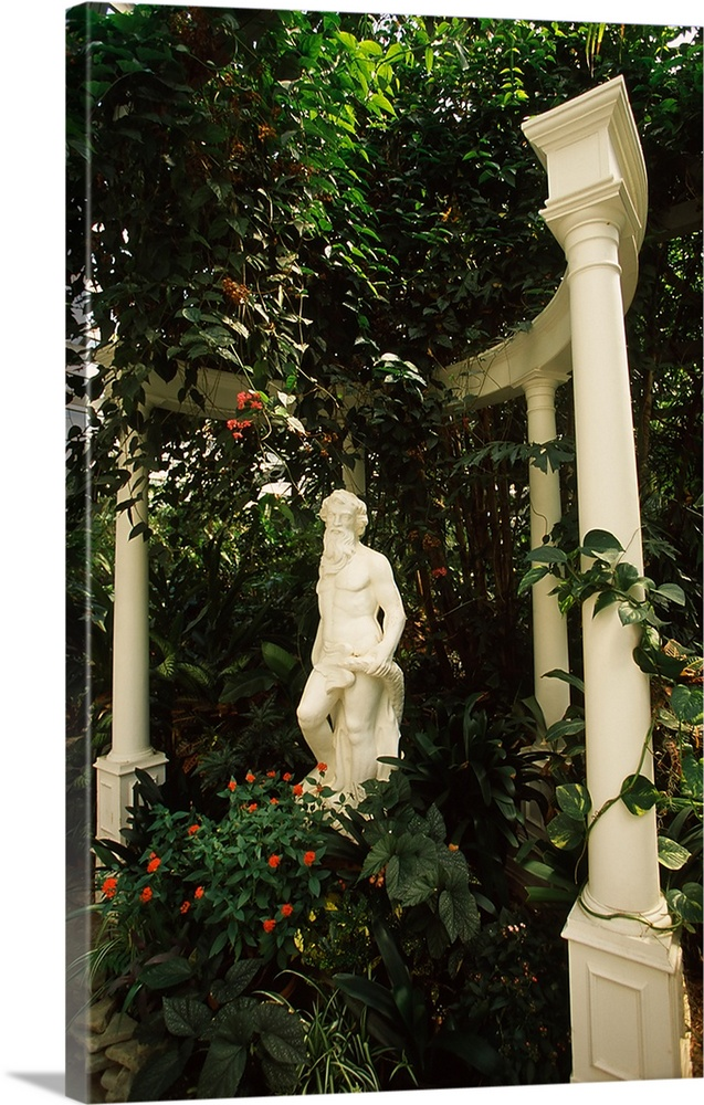 Large Solid-Faced Canvas Print Wall Art Print 20 x 30 entitled Statue in a garden, Magnolia Plantation And Gardens, Charle... Solid-Faced Canvas Print entitled Statue in a garden, Magnolia Plantation And Gardens, Charleston, Charleston County, South Carolina,.  Multiple sizes available.  Primary colors within this image include Dark Red, Forest Green, White, Dark Forest Green.  Made in the USA.  All products come with a 365 day workmanship guarantee.  Archival-quality UV-resistant inks.  Featuring a proprietary design, our canvases produce the tightest corners without any bubbles, ripples, or bumps and will not warp or sag over time.  Archival inks prevent fading and preserve as much fine detail as possible with no over-saturation or color shifting.