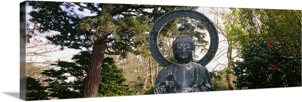 Large Solid-Faced Canvas Print Wall Art Print 48 x 16 entitled Statue of Buddha in a park, Japanese Tea Garden, Golden Gat... Solid-Faced Canvas Print entitled Statue of Buddha in a park, Japanese Tea Garden, Golden Gate Park, San Francisco, California.  This Buddha statue is pictured as a panorama with trees scattered about in the background.  Multiple sizes available.  Primary colors within this image include Dark Red, Dark Yellow, White, Dark Forest Green.  Made in the USA.  All products come with a 365 day workmanship guarantee.  Inks used are latex-based and designed to last.  Canvas is handcrafted and made-to-order in the United States using high quality artist-grade canvas.  Archival inks prevent fading and preserve as much fine detail as possible with no over-saturation or color shifting.