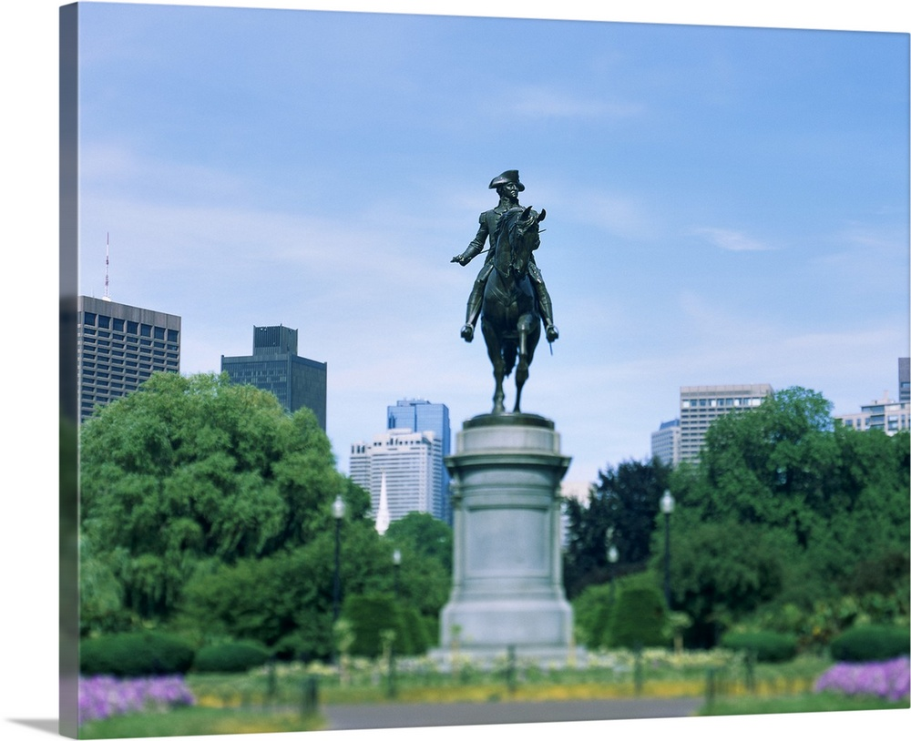 Large Solid-Faced Canvas Print Wall Art Print 30 x 24 entitled Statue of George Washington in a garden, Boston, Massachusetts Solid-Faced Canvas Print entitled Statue of George Washington in a garden, Boston, Massachusetts.  Multiple sizes available.  Primary colors within this image include Sky Blue, Dark Forest Green, Dark Navy Blue.  Made in the USA.  All products come with a 365 day workmanship guarantee.  Inks used are latex-based and designed to last.  Canvas is handcrafted and made-to-order in the United States using high quality artist-grade canvas.  Featuring a proprietary design, our canvases produce the tightest corners without any bubbles, ripples, or bumps and will not warp or sag over time.