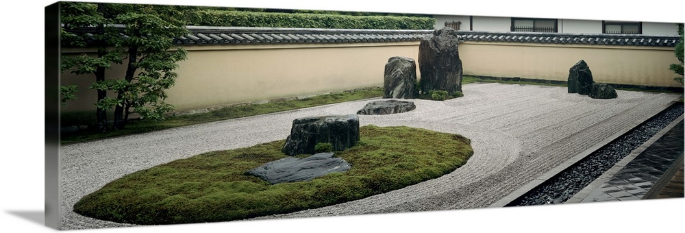 Large Solid-Faced Canvas Print Wall Art Print 36 x 12 entitled Statues in a garden, Rock Garden, Ryoanji Temple, Ryogen-in... Solid-Faced Canvas Print entitled Statues in a garden, Rock Garden, Ryoanji Temple, Ryogen-in, Kyoto Japan.  Multiple sizes available.  Primary colors within this image include Black, Light Gray, Dark Forest Green.  Made in the USA.  Satisfaction guaranteed.  Inks used are latex-based and designed to last.  Canvas depth is 1.25 and includes a finished backing with pre-installed hanging hardware.  Canvas is handcrafted and made-to-order in the United States using high quality artist-grade canvas.