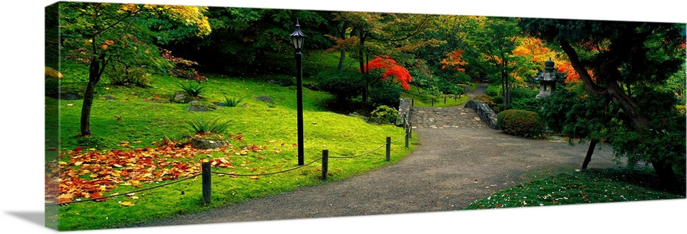 Large Solid-Faced Canvas Print Wall Art Print 48 x 16 entitled Stone Bridge The Japanese Garden Seattle WA Solid-Faced Canvas Print entitled Stone Bridge The Japanese Garden Seattle WA.  Multiple sizes available.  Primary colors within this image include Orange, Yellow, Forest Green, Dark Forest Green.  Made in USA.  All products come with a 365 day workmanship guarantee.  Inks used are latex-based and designed to last.  Archival inks prevent fading and preserve as much fine detail as possible with no over-saturation or color shifting.  Canvas is handcrafted and made-to-order in the United States using high quality artist-grade canvas.