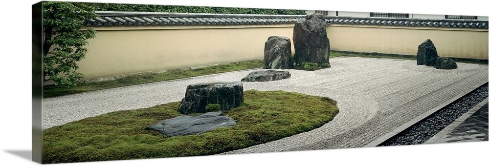 Large Solid-Faced Canvas Print Wall Art Print 36 x 12 entitled Stones in a garden, Zen Garden, Ryogen-In Temple, Kyoto Pre... Solid-Faced Canvas Print entitled Stones in a garden, Zen Garden, Ryogen-In Temple, Kyoto Prefecture, Honshu, Japan.  Multiple sizes available.  Primary colors within this image include Black, Silver, Dark Forest Green.  Made in the USA.  All products come with a 365 day workmanship guarantee.  Archival-quality UV-resistant inks.  Canvas is handcrafted and made-to-order in the United States using high quality artist-grade canvas.  Canvas depth is 1.25 and includes a finished backing with pre-installed hanging hardware.