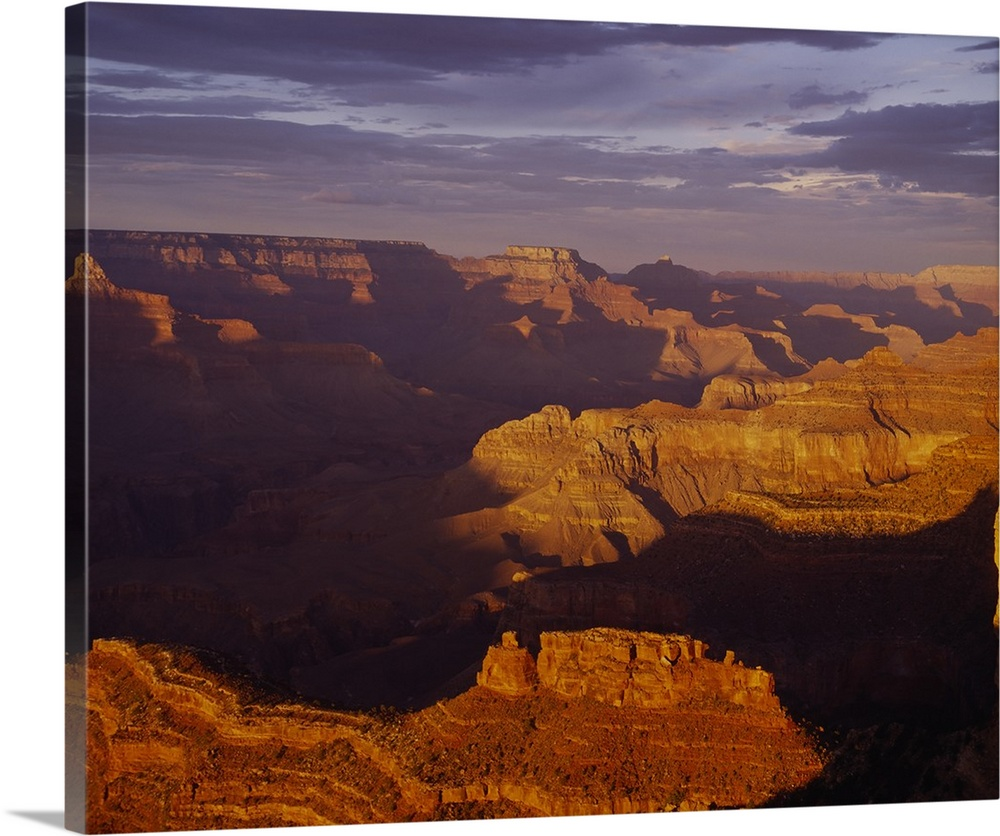 Large Solid-Faced Canvas Print Wall Art Print 30 x 24 entitled Sunset Grand Canyon National Park AZ Solid-Faced Canvas Print entitled Sunset Grand Canyon National Park AZ.  Vista of an arid desert canyon with strong shadows created by the late afternoon sun in the Southwest, with layers of rock easily visible.  Multiple sizes available.  Primary colors within this image include Brown, Dark Gray, Light Gray.  Made in the USA.  Satisfaction guaranteed.  Archival-quality UV-resistant inks.  Canvas depth is 1.25 and includes a finished backing with pre-installed hanging hardware.  Canvas is handcrafted and made-to-order in the United States using high quality artist-grade canvas.