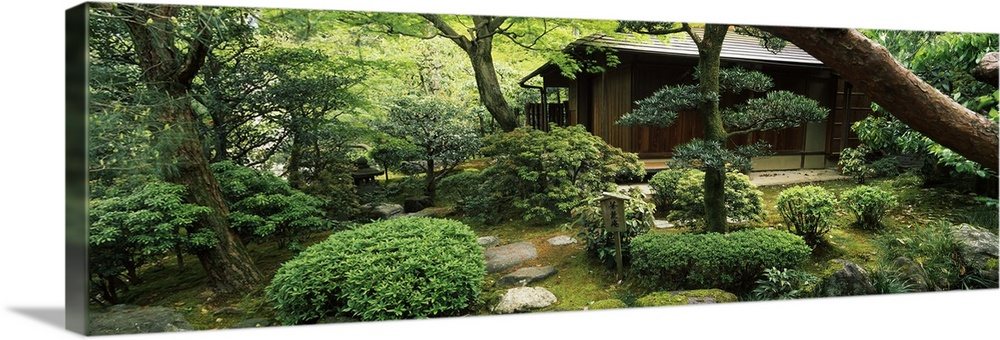 Large Solid-Faced Canvas Print Wall Art Print 48 x 16 entitled Temple in a garden, Yuzen-En Garden, Chion-In, Higashiyama ... Solid-Faced Canvas Print entitled Temple in a garden, Yuzen-En Garden, Chion-In, Higashiyama Ward, Kyoto, Kyoto Prefecture, Kinki Region, Honshu, Japan.  Multiple sizes available.  Primary colors within this image include Dark Yellow, Light Yellow, Silver, Dark Forest Green.  Made in the USA.  Satisfaction guaranteed.  Inks used are latex-based and designed to last.  Canvas is handcrafted and made-to-order in the United States using high quality artist-grade canvas.  Canvas depth is 1.25 and includes a finished backing with pre-installed hanging hardware.