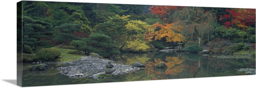 Large Solid-Faced Canvas Print Wall Art Print 48 x 16 entitled The Japanese Garden Seattle WA Solid-Faced Canvas Print entitled The Japanese Garden Seattle WA.  Giant panoramic photo of the Japanese Garden in Seattle, Washington WA with trees and stones lining a body of water. Green trees on the left are contrasted by trees with changing autumn leaf colors on the right.  Multiple sizes available.  Primary colors within this image include Dark Yellow, Dark Gray.  Made in USA.  Satisfaction guaranteed.  Archival-quality UV-resistant inks.  Canvas is handcrafted and made-to-order in the United States using high quality artist-grade canvas.  Featuring a proprietary design, our canvases produce the tightest corners without any bubbles, ripples, or bumps and will not warp or sag over time.