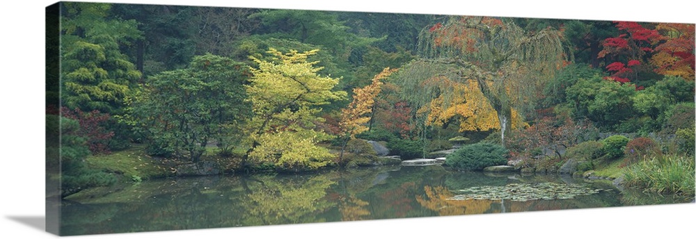 Large Solid-Faced Canvas Print Wall Art Print 48 x 16 entitled The Japanese Garden Seattle WA Solid-Faced Canvas Print entitled The Japanese Garden Seattle WA.  Multiple sizes available.  Primary colors within this image include Dark Red, Dark Yellow, Black, Gray.  Made in USA.  All products come with a 365 day workmanship guarantee.  Archival-quality UV-resistant inks.  Canvas depth is 1.25 and includes a finished backing with pre-installed hanging hardware.  Canvas is handcrafted and made-to-order in the United States using high quality artist-grade canvas.