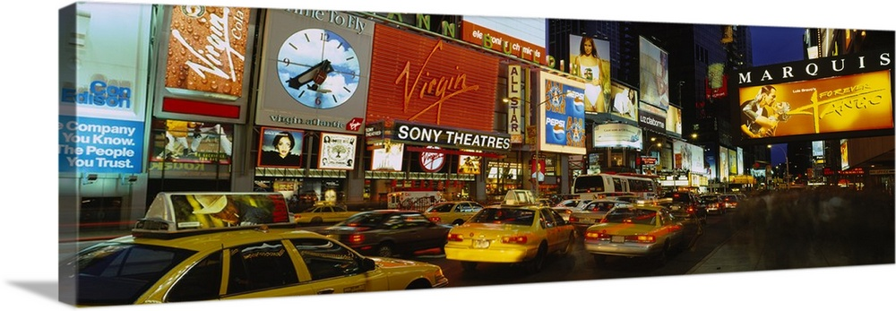 Large Solid-Faced Canvas Print Wall Art Print 48 x 16 entitled Times Square, Manhattan, New York City, New York Solid-Faced Canvas Print entitled Times Square, Manhattan, New York City, New York.  Multiple sizes available.  Primary colors within this image include Yellow, Brown, Black, Royal Blue.  Made in the USA.  All products come with a 365 day workmanship guarantee.  Archival-quality UV-resistant inks.  Archival inks prevent fading and preserve as much fine detail as possible with no over-saturation or color shifting.  Featuring a proprietary design, our canvases produce the tightest corners without any bubbles, ripples, or bumps and will not warp or sag over time.