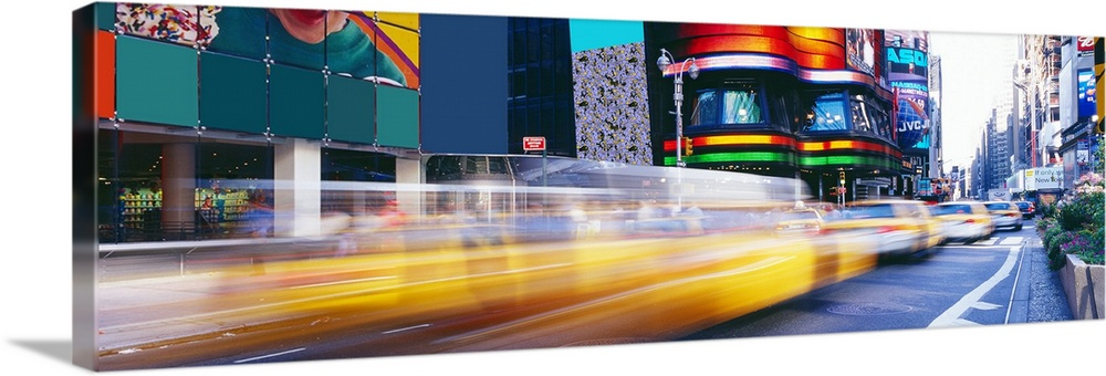 Large Solid-Faced Canvas Print Wall Art Print 48 x 16 entitled Times Square New York New York Solid-Faced Canvas Print entitled Times Square New York New York.  Panorama of New York Citys Times Square and fast paced yellow cabs.  Multiple sizes available.  Primary colors within this image include Red, Yellow, Pale Blue, Dark Navy Blue.  Made in the USA.  Satisfaction guaranteed.  Inks used are latex-based and designed to last.  Archival inks prevent fading and preserve as much fine detail as possible with no over-saturation or color shifting.  Featuring a proprietary design, our canvases produce the tightest corners without any bubbles, ripples, or bumps and will not warp or sag over time.