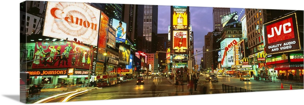 Large Solid-Faced Canvas Print Wall Art Print 48 x 16 entitled Times Square New York NY Solid-Faced Canvas Print entitled Times Square New York NY.  Wide angle photograph of Times Square in New York City, lit at night, with billboards including Canon, JVC, and Diet Coke.  Multiple sizes available.  Primary colors within this image include Red, Light Yellow, Dark Gray, White.  Made in USA.  All products come with a 365 day workmanship guarantee.  Inks used are latex-based and designed to last.  Archival inks prevent fading and preserve as much fine detail as possible with no over-saturation or color shifting.  Featuring a proprietary design, our canvases produce the tightest corners without any bubbles, ripples, or bumps and will not warp or sag over time.