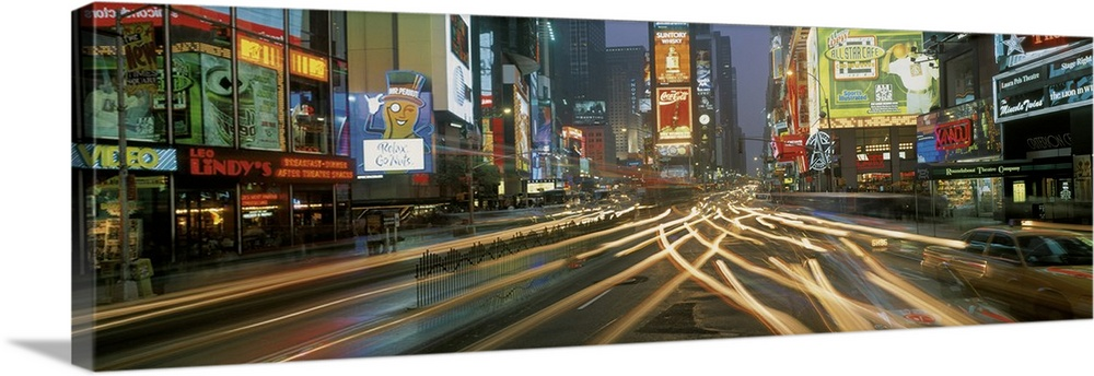 Large Solid-Faced Canvas Print Wall Art Print 48 x 16 entitled Times Square New York NY Solid-Faced Canvas Print entitled Times Square New York NY .  Multiple sizes available.  Primary colors within this image include Brown, Black, Gray, Silver.  Made in the USA.  All products come with a 365 day workmanship guarantee.  Archival-quality UV-resistant inks.  Canvas is handcrafted and made-to-order in the United States using high quality artist-grade canvas.  Featuring a proprietary design, our canvases produce the tightest corners without any bubbles, ripples, or bumps and will not warp or sag over time.