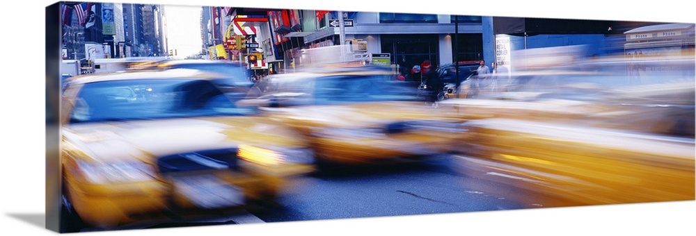 Large Solid-Faced Canvas Print Wall Art Print 48 x 16 entitled Times Square New York NY Solid-Faced Canvas Print entitled Times Square New York NY.  Multiple sizes available.  Primary colors within this image include Dark Red, Light Yellow, White, Dark Navy Blue.  Made in the USA.  All products come with a 365 day workmanship guarantee.  Archival-quality UV-resistant inks.  Canvas is handcrafted and made-to-order in the United States using high quality artist-grade canvas.  Featuring a proprietary design, our canvases produce the tightest corners without any bubbles, ripples, or bumps and will not warp or sag over time.