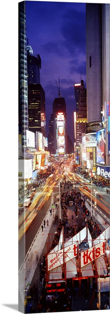 Large Solid-Faced Canvas Print Wall Art Print 16 x 48 entitled Times Square New York NY Solid-Faced Canvas Print entitled Times Square New York NY.  Vertical panoramic of a busy Times Square at night with traffic lined streets and tourists in line to buy theatre tickets.  Multiple sizes available.  Primary colors within this image include Dark Red, Dark Blue, Black, White.  Made in the USA.  All products come with a 365 day workmanship guarantee.  Archival-quality UV-resistant inks.  Canvas is handcrafted and made-to-order in the United States using high quality artist-grade canvas.  Canvas depth is 1.25 and includes a finished backing with pre-installed hanging hardware.