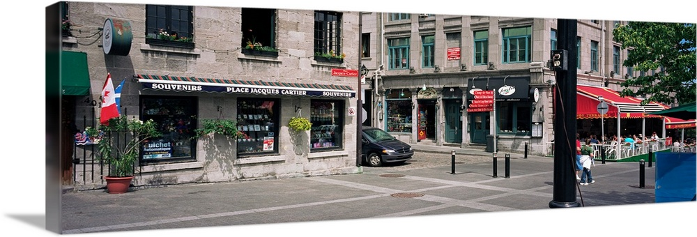 Large Gallery-Wrapped Canvas Wall Art Print 30 x 10 entitled Tourist sitting at a sidewalk cafe, Place Jacques Cartier, Mo... Gallery-Wrapped Canvas entitled Tourist sitting at a sidewalk cafe, Place Jacques Cartier, Montreal, Quebec, Canada.  Multiple sizes available.  Primary colors within this image include Pink, White, Muted Blue, Dark Forest Green.  Made in USA.  Satisfaction guaranteed.  Archival-quality UV-resistant inks.  Canvas frames are built with farmed or reclaimed domestic pine or poplar wood.  Museum-quality, artist-grade canvas mounted on sturdy wooden stretcher bars 1.5 thick.  Comes ready to hang.