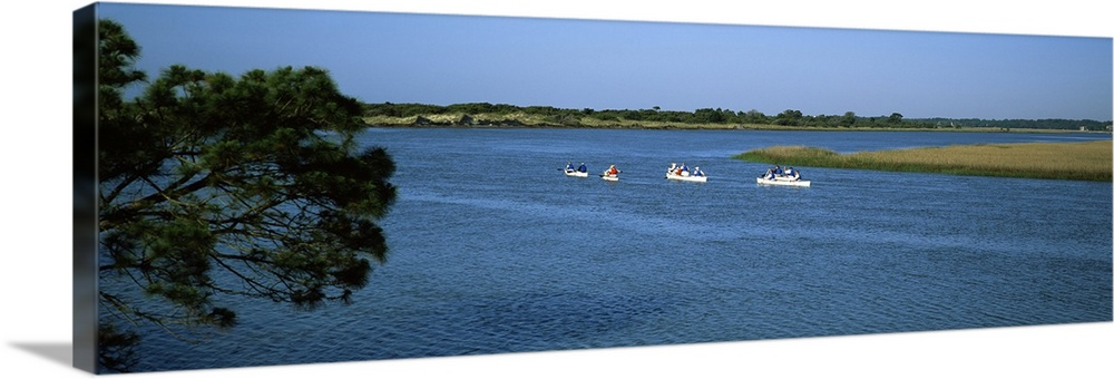 Solid-Faced Canvas Print Wall Art entitled Tourists kayaking in the sea, Kiawah