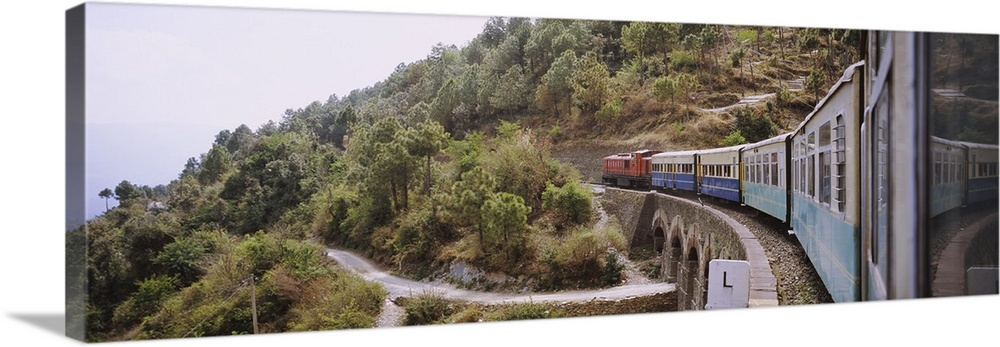 Large Solid-Faced Canvas Print Wall Art Print 48 x 16 entitled Toy train passing over a bridge, Himachal Pradesh, India Solid-Faced Canvas Print entitled Toy train passing over a bridge, Himachal Pradesh, India.  Multiple sizes available.  Primary colors within this image include Black, Gray, White.  Made in USA.  Satisfaction guaranteed.  Archival-quality UV-resistant inks.  Archival inks prevent fading and preserve as much fine detail as possible with no over-saturation or color shifting.  Featuring a proprietary design, our canvases produce the tightest corners without any bubbles, ripples, or bumps and will not warp or sag over time.