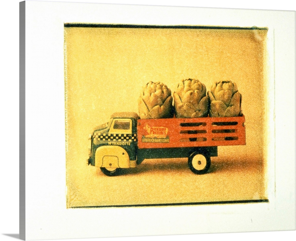 Large Solid-Faced Canvas Print Wall Art Print 30 x 24 entitled Toy truck carrying artichokes Solid-Faced Canvas Print entitled Toy truck carrying artichokes.  Multiple sizes available.  Primary colors within this image include Orange, Brown, Light Yellow, White.  Made in the USA.  Satisfaction guaranteed.  Archival-quality UV-resistant inks.  Archival inks prevent fading and preserve as much fine detail as possible with no over-saturation or color shifting.  Featuring a proprietary design, our canvases produce the tightest corners without any bubbles, ripples, or bumps and will not warp or sag over time.
