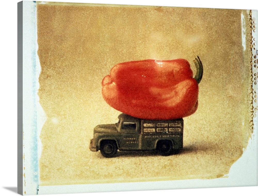 Large Solid-Faced Canvas Print Wall Art Print 24 x 18 entitled Toy truck carrying red pepper Solid-Faced Canvas Print entitled Toy truck carrying red pepper.  Multiple sizes available.  Primary colors within this image include Dark Red, Black, White, Dark Forest Green.  Made in USA.  All products come with a 365 day workmanship guarantee.  Inks used are latex-based and designed to last.  Archival inks prevent fading and preserve as much fine detail as possible with no over-saturation or color shifting.  Canvas depth is 1.25 and includes a finished backing with pre-installed hanging hardware.
