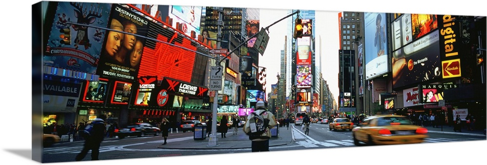 Large Solid-Faced Canvas Print Wall Art Print 48 x 16 entitled Traffic on a road, Times Square, New York City, New York Solid-Faced Canvas Print entitled Traffic on a road, Times Square, New York City, New York.  Times Square, NYC with neon signs.  Multiple sizes available.  Primary colors within this image include Red, Dark Red, Light Yellow, Dark Forest Green.  Made in the USA.  All products come with a 365 day workmanship guarantee.  Archival-quality UV-resistant inks.  Canvas is handcrafted and made-to-order in the United States using high quality artist-grade canvas.  Canvas depth is 1.25 and includes a finished backing with pre-installed hanging hardware.
