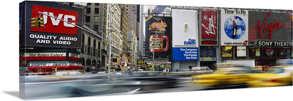 Large Solid-Faced Canvas Print Wall Art Print 48 x 16 entitled Traffic on a street, Times Square, Manhattan, New York City... Solid-Faced Canvas Print entitled Traffic on a street, Times Square, Manhattan, New York City, New York State.  Multiple sizes available.  Primary colors within this image include Dark Red, Brown, Dark Blue, Black.  Made in the USA.  All products come with a 365 day workmanship guarantee.  Archival-quality UV-resistant inks.  Canvas depth is 1.25 and includes a finished backing with pre-installed hanging hardware.  Canvas is handcrafted and made-to-order in the United States using high quality artist-grade canvas.