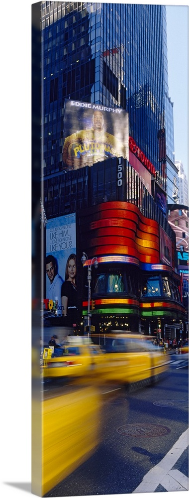 Large Solid-Faced Canvas Print Wall Art Print 16 x 48 entitled Traffic on a street, Times Square, Manhattan, New York City... Solid-Faced Canvas Print entitled Traffic on a street, Times Square, Manhattan, New York City, New York State.  Multiple sizes available.  Primary colors within this image include Dark Yellow, Black, Pale Blue, Dark Navy Blue.  Made in the USA.  All products come with a 365 day workmanship guarantee.  Inks used are latex-based and designed to last.  Archival inks prevent fading and preserve as much fine detail as possible with no over-saturation or color shifting.  Canvas depth is 1.25 and includes a finished backing with pre-installed hanging hardware.