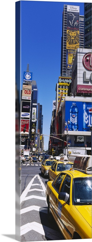 Large Solid-Faced Canvas Print Wall Art Print 16 x 48 entitled Traffic on a street, Times Square, Manhattan, New York City... Solid-Faced Canvas Print entitled Traffic on a street, Times Square, Manhattan, New York City, New York State.  Vertical panoramic photograph taken of a busy street in Times Square.  Multiple sizes available.  Primary colors within this image include Yellow, Brown, Dark Blue, White.  Made in the USA.  Satisfaction guaranteed.  Archival-quality UV-resistant inks.  Archival inks prevent fading and preserve as much fine detail as possible with no over-saturation or color shifting.  Canvas depth is 1.25 and includes a finished backing with pre-installed hanging hardware.