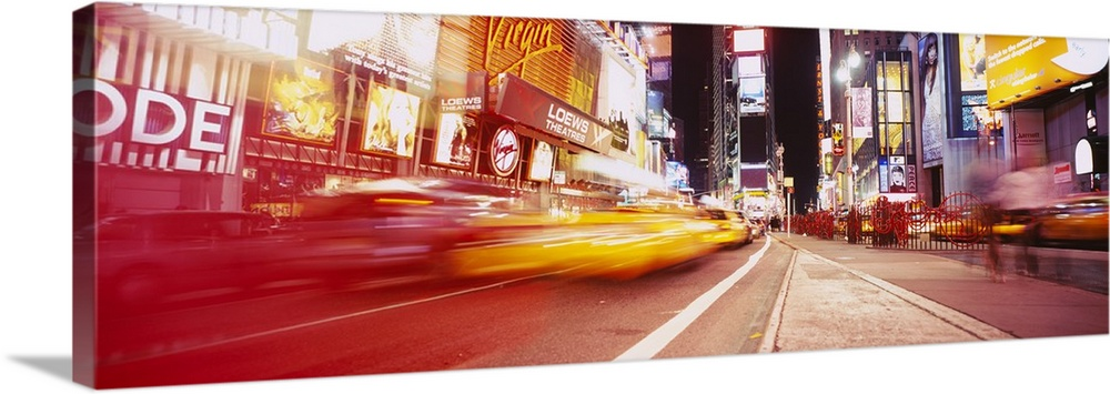 Large Solid-Faced Canvas Print Wall Art Print 48 x 16 entitled Traffic on the road, Times Square, Manhattan, New York City... Solid-Faced Canvas Print entitled Traffic on the road, Times Square, Manhattan, New York City, New York State.  Big, horizontal photograph of blurred traffic driving down the road leading through Times Square, at night in New York City.  Multiple sizes available.  Primary colors within this image include Orange, Dark Red, Black, Silver.  Made in USA.  Satisfaction guaranteed.  Inks used are latex-based and designed to last.  Canvas depth is 1.25 and includes a finished backing with pre-installed hanging hardware.  Featuring a proprietary design, our canvases produce the tightest corners without any bubbles, ripples, or bumps and will not warp or sag over time.