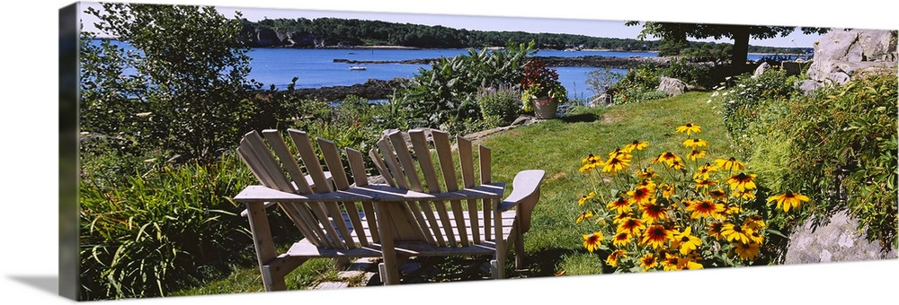 Large Solid-Faced Canvas Print Wall Art Print 48 x 16 entitled Two adirondack chairs in a garden, Peaks Island, Casco Bay,... Solid-Faced Canvas Print entitled Two adirondack chairs in a garden, Peaks Island, Casco Bay, Maine.  Panoramic picture taken of two chairs that sit in a garden overlooking a body of water.  Multiple sizes available.  Primary colors within this image include Dark Yellow, Light Yellow, Dark Forest Green, Pale Blue.  Made in USA.  Satisfaction guaranteed.  Inks used are latex-based and designed to last.  Featuring a proprietary design, our canvases produce the tightest corners without any bubbles, ripples, or bumps and will not warp or sag over time.  Canvas depth is 1.25 and includes a finished backing with pre-installed hanging hardware.