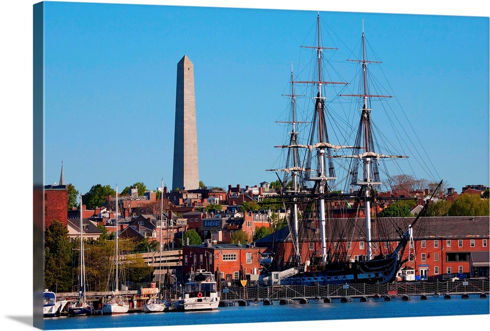 Large Solid-Faced Canvas Print Wall Art Print 36 x 24 entitled USS Constitution historic ship, Freedom Trail, Charlestown,... Solid-Faced Canvas Print entitled USS Constitution historic ship, Freedom Trail, Charlestown, Boston, MA.  USS Constitution historic ship, Old Ironsides a Three Masted Frigit, is seen near Bunker Hill Monument on harbor,, Freedom Trail, Charlestown, Boston, MA.  Multiple sizes available.  Primary colors within this image include Pink, Sky Blue, Dark Forest Green, Dark Navy Blue.  Made in USA.  Satisfaction guaranteed.  Archival-quality UV-resistant inks.  Featuring a proprietary design, our canvases produce the tightest corners without any bubbles, ripples, or bumps and will not warp or sag over time.  Canvas is handcrafted and made-to-order in the United States using high quality artist-grade canvas.