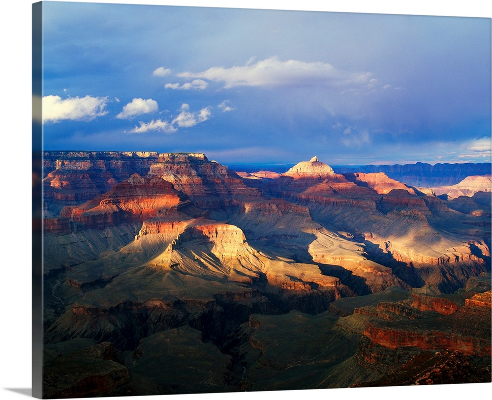 Large Solid-Faced Canvas Print Wall Art Print 30 x 24 entitled View of Grand Canyon from Shoshone Point, storm cloud shado... Solid-Faced Canvas Print entitled View of Grand Canyon from Shoshone Point, storm cloud shadows, south rim, Grand Canyon National Park, Arizona.  This landscape photograph captures the light passing through the approaching storm and hitting the rock face of several canyon ridges.  Multiple sizes available.  Primary colors within this image include Dark Red, Peach, Black, Muted Blue.  Made in USA.  All products come with a 365 day workmanship guarantee.  Archival-quality UV-resistant inks.  Canvas is handcrafted and made-to-order in the United States using high quality artist-grade canvas.  Featuring a proprietary design, our canvases produce the tightest corners without any bubbles, ripples, or bumps and will not warp or sag over time.