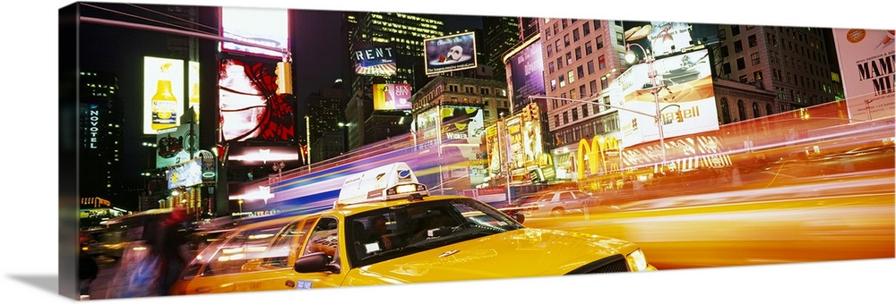 Large Solid-Faced Canvas Print Wall Art Print 48 x 16 entitled Yellow taxi on the road, Times Square, Manhattan, New York ... Solid-Faced Canvas Print entitled Yellow taxi on the road, Times Square, Manhattan, New York City, New York State.  Yellow taxi on the road, Times Square, Manhattan, New York City, New York State, USA.  Multiple sizes available.  Primary colors within this image include Orange, Dark Yellow, Black, White.  Made in the USA.  All products come with a 365 day workmanship guarantee.  Archival-quality UV-resistant inks.  Featuring a proprietary design, our canvases produce the tightest corners without any bubbles, ripples, or bumps and will not warp or sag over time.  Archival inks prevent fading and preserve as much fine detail as possible with no over-saturation or color shifting.