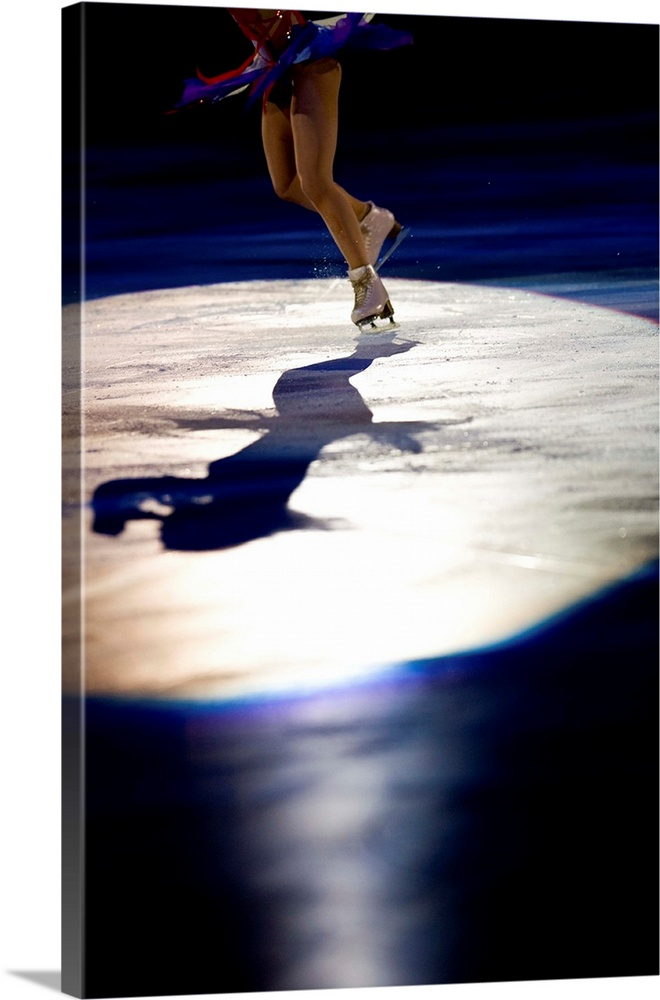 Large Solid-Faced Canvas Print Wall Art Print 20 x 30 entitled Shadow of female figure skater in action Solid-Faced Canvas Print entitled Shadow of female figure skater in action.  Multiple sizes available.  Primary colors within this image include Dark Red, Dark Blue, Black, White.  Made in USA.  Satisfaction guaranteed.  Inks used are latex-based and designed to last.  Archival inks prevent fading and preserve as much fine detail as possible with no over-saturation or color shifting.  Featuring a proprietary design, our canvases produce the tightest corners without any bubbles, ripples, or bumps and will not warp or sag over time.