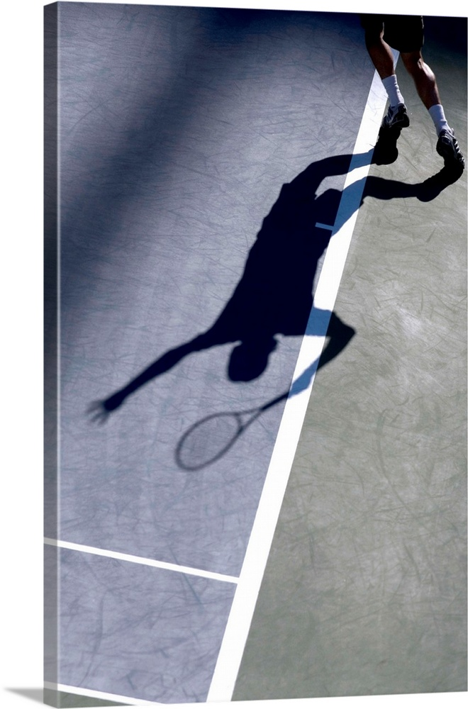 Large Solid-Faced Canvas Print Wall Art Print 20 x 30 entitled Shadow of tennis player serving Solid-Faced Canvas Print entitled Shadow of tennis player serving.  TN0417 106000.  Multiple sizes available.  Primary colors within this image include Dark Navy Blue, Light Gray Blue.  Made in the USA.  All products come with a 365 day workmanship guarantee.  Archival-quality UV-resistant inks.  Canvas is handcrafted and made-to-order in the United States using high quality artist-grade canvas.  Canvas depth is 1.25 and includes a finished backing with pre-installed hanging hardware.