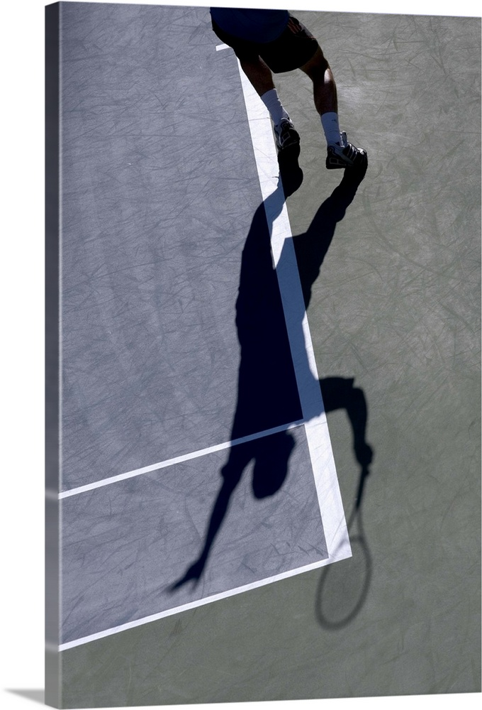Large Solid-Faced Canvas Print Wall Art Print 20 x 30 entitled Shadow of tennis player serving Solid-Faced Canvas Print entitled Shadow of tennis player serving.  TN0417 106001.  Multiple sizes available.  Primary colors within this image include Black, Gray, White.  Made in USA.  Satisfaction guaranteed.  Inks used are latex-based and designed to last.  Featuring a proprietary design, our canvases produce the tightest corners without any bubbles, ripples, or bumps and will not warp or sag over time.  Archival inks prevent fading and preserve as much fine detail as possible with no over-saturation or color shifting.