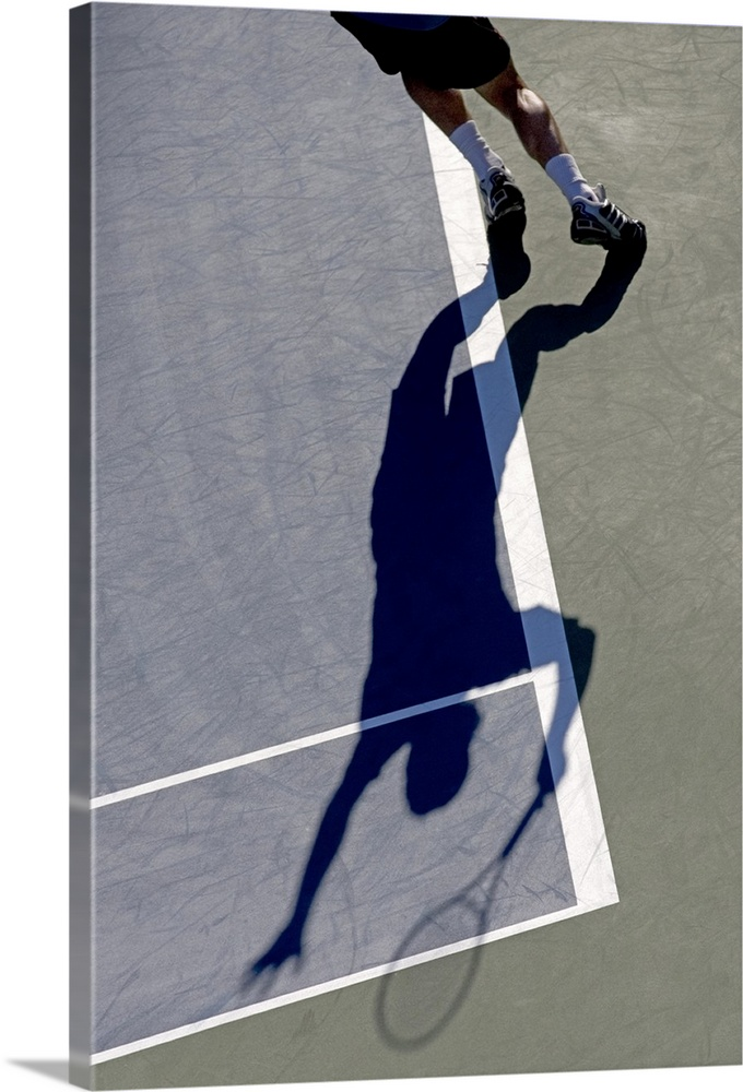 Large Solid-Faced Canvas Print Wall Art Print 20 x 30 entitled Shadow of tennis player serving Solid-Faced Canvas Print entitled Shadow of tennis player serving.  TN0417 106002.  Multiple sizes available.  Primary colors within this image include Dark Blue, Black, Light Gray.  Made in USA.  All products come with a 365 day workmanship guarantee.  Inks used are latex-based and designed to last.  Canvas is handcrafted and made-to-order in the United States using high quality artist-grade canvas.  Featuring a proprietary design, our canvases produce the tightest corners without any bubbles, ripples, or bumps and will not warp or sag over time.