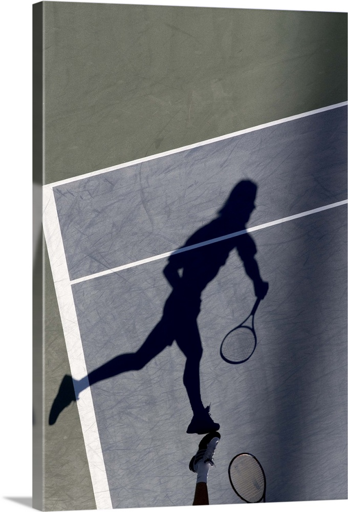 Large Solid-Faced Canvas Print Wall Art Print 20 x 30 entitled Shadow of tennis player serving Solid-Faced Canvas Print entitled Shadow of tennis player serving.  TN0417 106006.  Multiple sizes available.  Primary colors within this image include Gray, White, Dark Navy Blue.  Made in USA.  Satisfaction guaranteed.  Archival-quality UV-resistant inks.  Archival inks prevent fading and preserve as much fine detail as possible with no over-saturation or color shifting.  Featuring a proprietary design, our canvases produce the tightest corners without any bubbles, ripples, or bumps and will not warp or sag over time.
