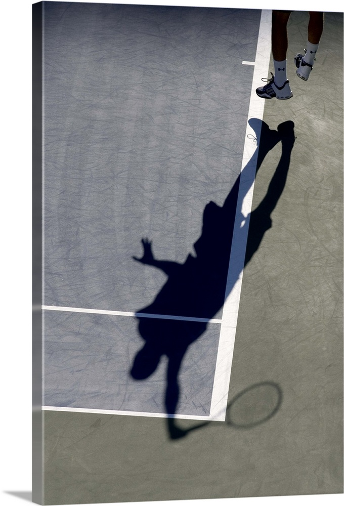 Large Solid-Faced Canvas Print Wall Art Print 20 x 30 entitled Shadow of tennis player serving Solid-Faced Canvas Print entitled Shadow of tennis player serving.  TN0417 106005.  Multiple sizes available.  Primary colors within this image include Light Gray, Dark Navy Blue.  Made in USA.  All products come with a 365 day workmanship guarantee.  Inks used are latex-based and designed to last.  Canvas depth is 1.25 and includes a finished backing with pre-installed hanging hardware.  Featuring a proprietary design, our canvases produce the tightest corners without any bubbles, ripples, or bumps and will not warp or sag over time.
