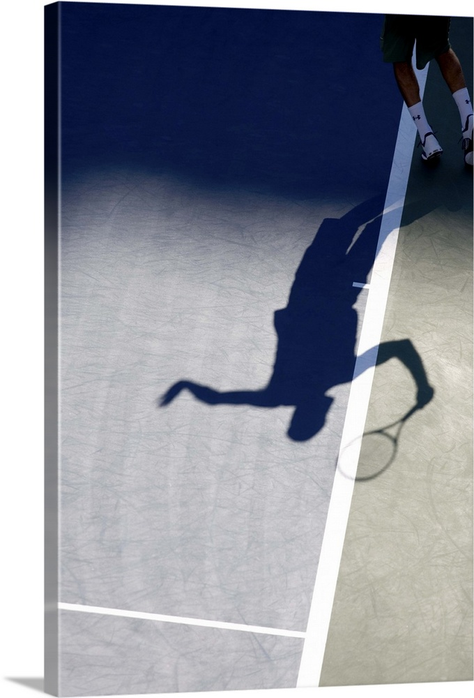 Large Solid-Faced Canvas Print Wall Art Print 20 x 30 entitled Shadow of tennis player serving Solid-Faced Canvas Print entitled Shadow of tennis player serving.  TN0417 106006.  Multiple sizes available.  Primary colors within this image include Gray, White, Dark Navy Blue.  Made in the USA.  Satisfaction guaranteed.  Inks used are latex-based and designed to last.  Canvas depth is 1.25 and includes a finished backing with pre-installed hanging hardware.  Featuring a proprietary design, our canvases produce the tightest corners without any bubbles, ripples, or bumps and will not warp or sag over time.