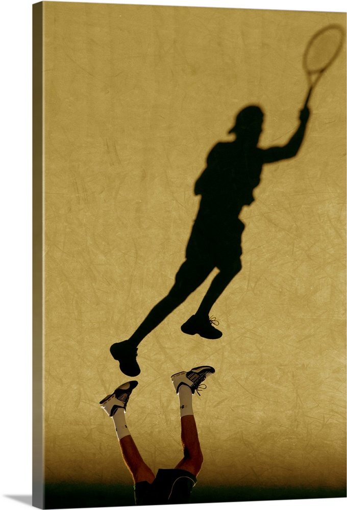 Large Solid-Faced Canvas Print Wall Art Print 20 x 30 entitled Shadow of tennis player serving Solid-Faced Canvas Print entitled Shadow of tennis player serving.  TN0417 106017.  Multiple sizes available.  Primary colors within this image include Brown, Peach, Black.  Made in USA.  All products come with a 365 day workmanship guarantee.  Archival-quality UV-resistant inks.  Canvas is handcrafted and made-to-order in the United States using high quality artist-grade canvas.  Archival inks prevent fading and preserve as much fine detail as possible with no over-saturation or color shifting.