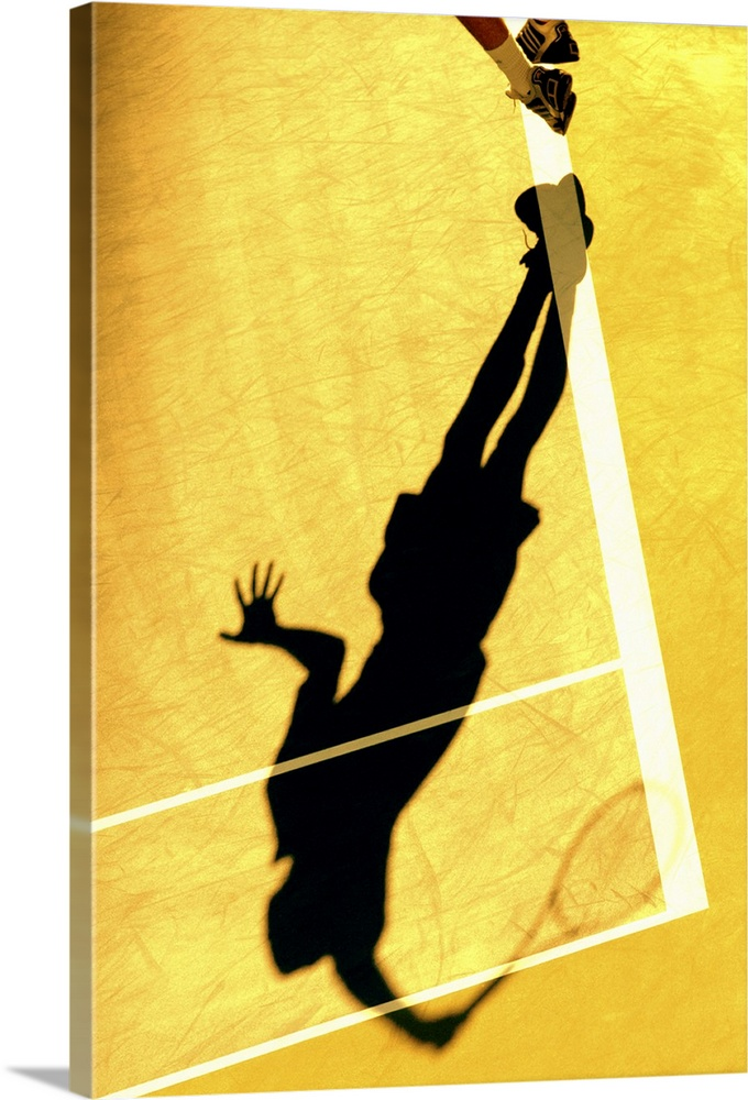 Large Solid-Faced Canvas Print Wall Art Print 20 x 30 entitled Shadow of tennis player serving Solid-Faced Canvas Print entitled Shadow of tennis player serving.  TN0417 106006.  Multiple sizes available.  Primary colors within this image include Brown, Light Yellow, Black, White.  Made in USA.  Satisfaction guaranteed.  Archival-quality UV-resistant inks.  Archival inks prevent fading and preserve as much fine detail as possible with no over-saturation or color shifting.  Canvas is handcrafted and made-to-order in the United States using high quality artist-grade canvas.