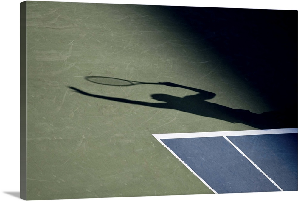 Large Solid-Faced Canvas Print Wall Art Print 30 x 20 entitled Shadow of tennis player serving Solid-Faced Canvas Print entitled Shadow of tennis player serving.  TN0417 106018.  Multiple sizes available.  Primary colors within this image include Black, Light Gray, White.  Made in the USA.  Satisfaction guaranteed.  Archival-quality UV-resistant inks.  Archival inks prevent fading and preserve as much fine detail as possible with no over-saturation or color shifting.  Canvas depth is 1.25 and includes a finished backing with pre-installed hanging hardware.